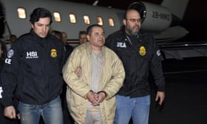 US law enforcement authorities escort Joaquín 'El Chapo' Guzmán from a plane to a waiting caravan of SUVs at Long Island MacArthur Airport, in New York, on 19 January 2017.