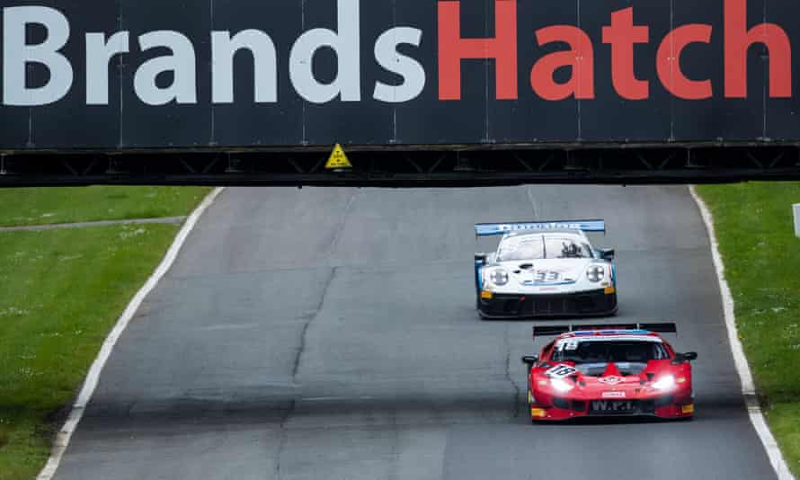 Race cars competing on the circuit at Brands Hatch in Kent.