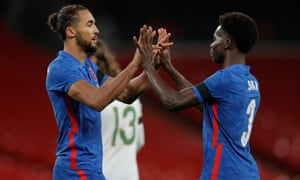 Dominic Calvert-Lewin (left) celebrates his goal with Bakaary Saka.