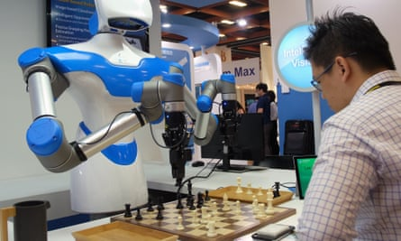 A man plays chess with a robot designed by Taiwan's Industrial Technology Research Institute (ITRI) in Taipei in 2017.