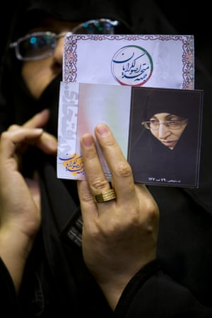 In this 2008 file photo, a supporter of parliamentary candidate Laleh Eftekhari holds up her picture.