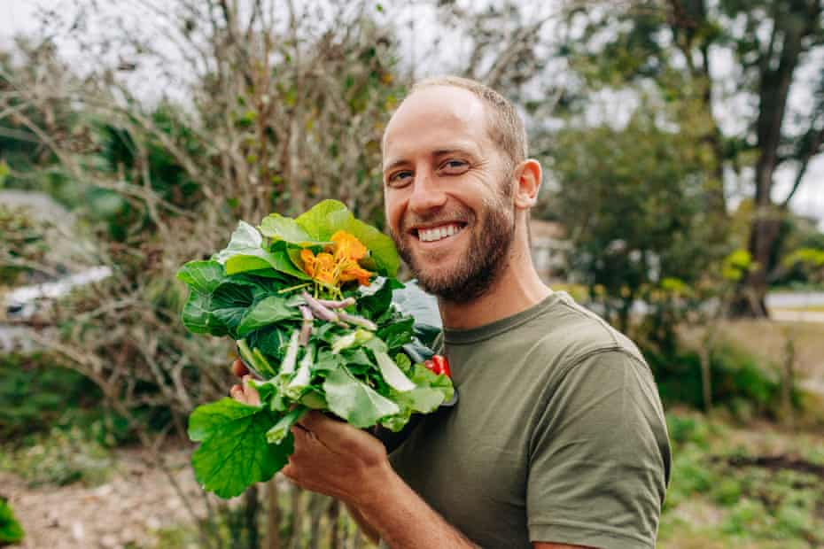 Rob Greenfield with greens grown in his garden.