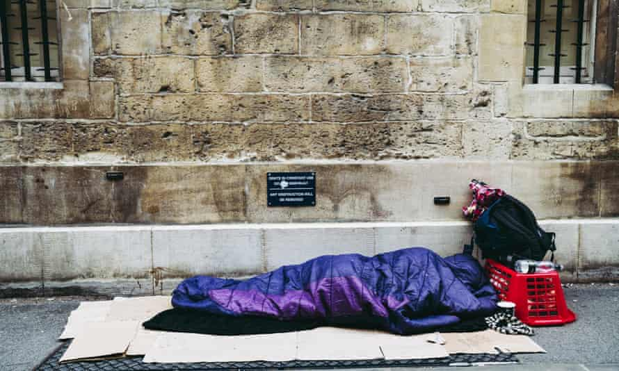A homeless person sleeps on the street in Oxford