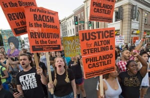 Black Lives Matter protesters march through the streets in Washington, DC