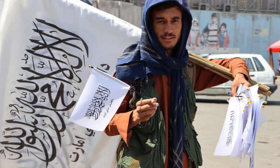Afghan man sells Taliban flags in Kabul