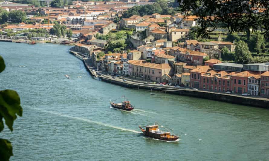 Boats sailing in Douro river Porto.