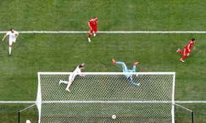 Fedor Smolov (right) scores Russia's second goal to secure victory.