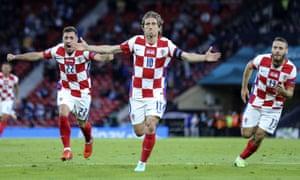 Croatia's Luka Modric (centre) celebrates after scoring his side's second goal.