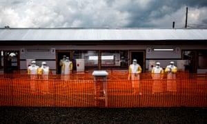 Health workers inside the red zone at a Médecins Sans Frontierès ebola treatment centre in DRC