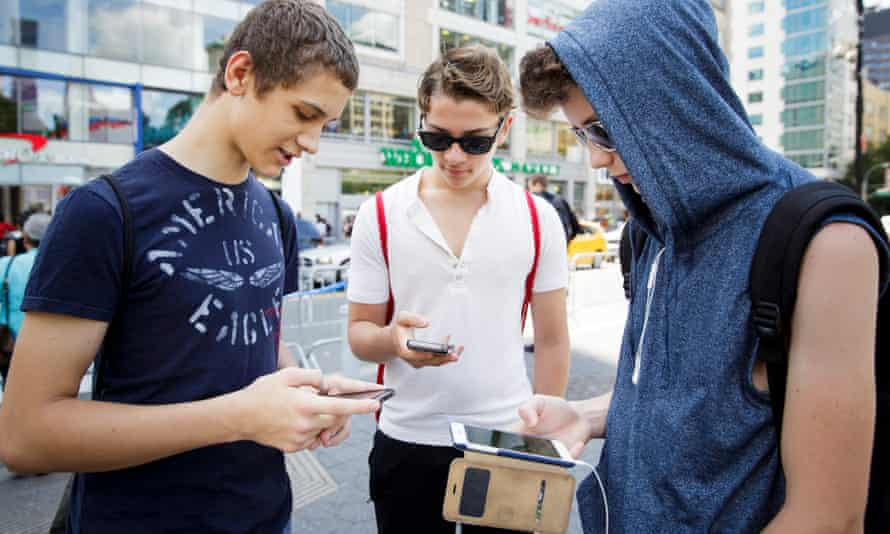 A group of people play the new game 'Pokémon Go' on their smartphones in Union Square in New York, New York