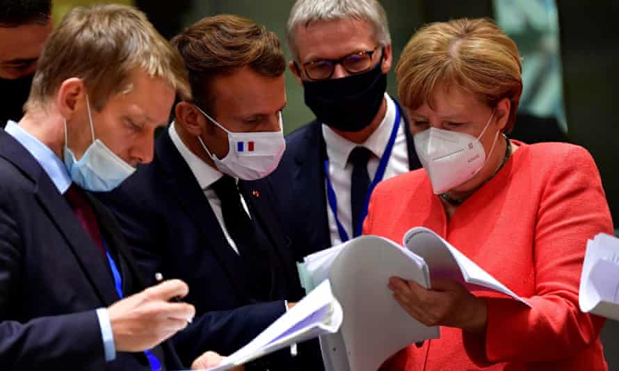Angela Merkel chats with France's Emmanuel Macron (second left) at the EU summit on Monday