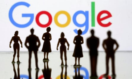 Small toy figures are seen in front of the Google logo