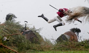 Jockey Nina Carberry flies off her horse Sir Des Champs during the Grand National steeplechase