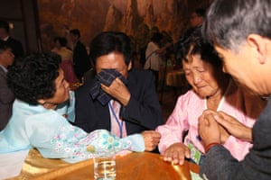 South Korean Kim Choon-sik (2nd L), 80, meets his North Korean sister Kim Choon-sil (L), 77.