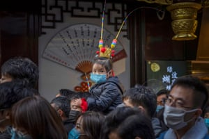 Shanghai, China. People walk through the Yuyuan Garden during the Spring festival, which lasts for 16 days, starting from Chinese new year from 11-26 February