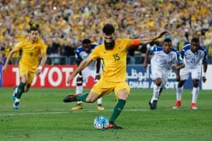 Jedinak slots home to give Australia an unassailable three-goal lead.