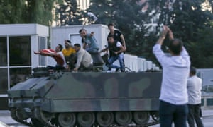 An armoured vehicle used in the coup attempt is taken over by police officers.