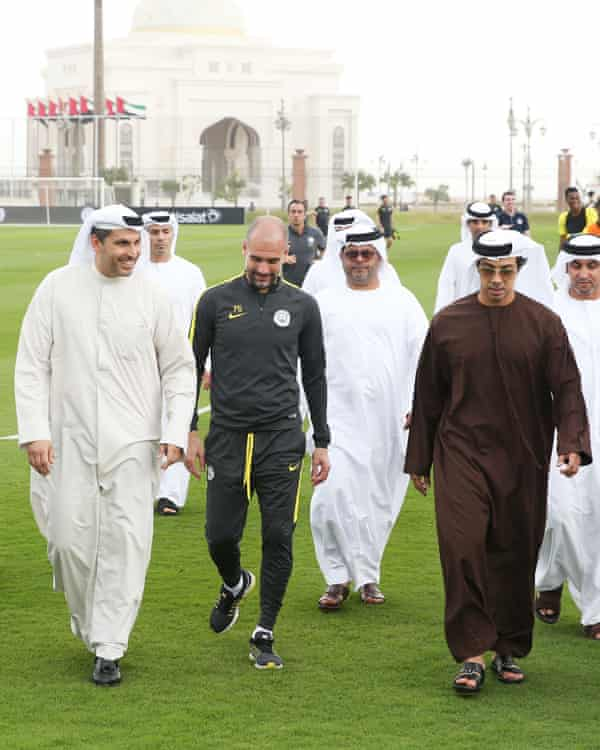 Sheikh Mansour (front right) with chairman of Manchester City FC Khaldoon al-Mubarak (front left) and Manchester City manager Pep Guardiola (front centre) at a training camp in Abu Dhabi, 2017.