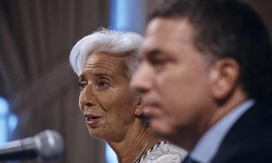 Argentina's treasury minister Nicolás Dujovne, right, listens as the IMF managing director, Christine Lagarde, left, speaks.
