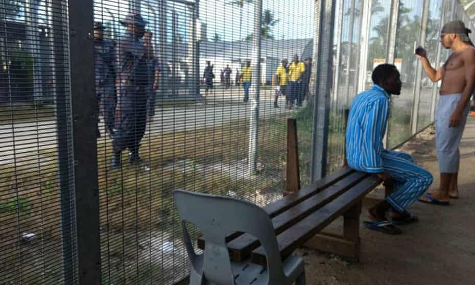 Police and detainees at the camp.