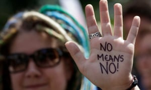 A protester shows writing on her that reads 'No means no!' at a protests against sexual violence in London.