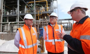 Josh Frydenberg and Malcolm Turnbull speak to a worker at the Ixom plant in Melbourne, on Friday.
