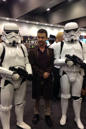 Paul Farrell dressed as Firefly's Malcolm Reynolds with Star Wars storm trooper cosplayers.