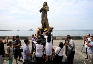Metro Manila, Philippines Flowers are placed at a memorial statue