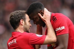 Juan Mata celebrates with Paul Pogba after scoring the opener for Manchester United against Chelsea at Old Trafford. Mata became the second player to score for both clubs in Premier League meetings between the two, after Mark Hughes.