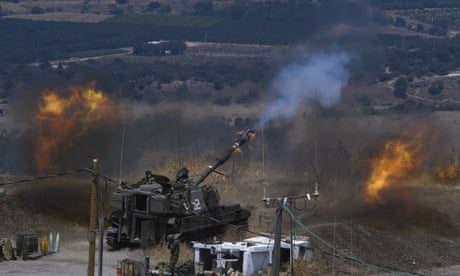 Israeli forces fire artillery from their position on the border with Lebanon after a barrage of rockets were fired from Lebanon.