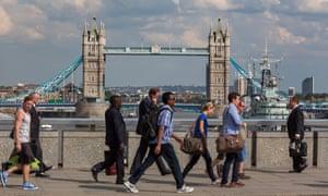 People crossing London Bridge.