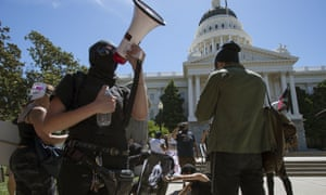 Anti-fascist activists stage a counter-protest against the Traditionalist Worker's party and the Golden State Skinheads at the State Capitol in Sacramento.