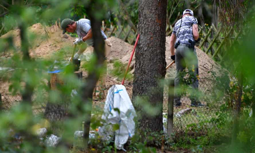 Police officers searching the garden plot in Hanover.