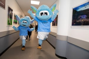 City's mascots bound through the corridors of Wembley on their way to the pitch.