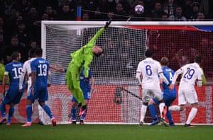 Wojciech Szczesny makes a save.
