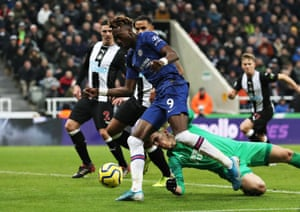 Chelsea's Tammy Abraham rounds Magpies keeper Martin Dubravka but can't find the net.