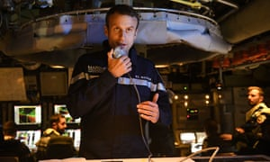 Macron speaks to the crew onboard the submarine Le Terrible on 4 July.