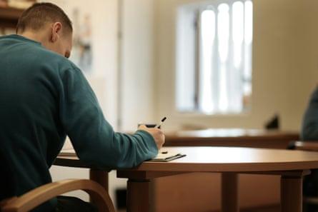 Prison inmate at a desk