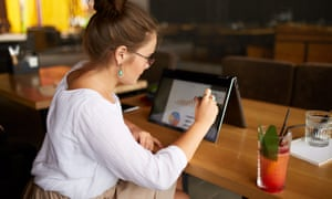 Businesswoman hand pointing with stylus on the chart over convertible laptop screen in tent mode