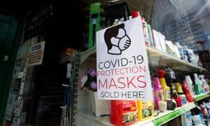 Shop advertising face masks for sale