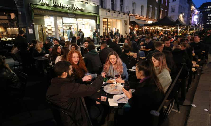People eating and drinking in Old Compton Street, London, 12 April 2021.