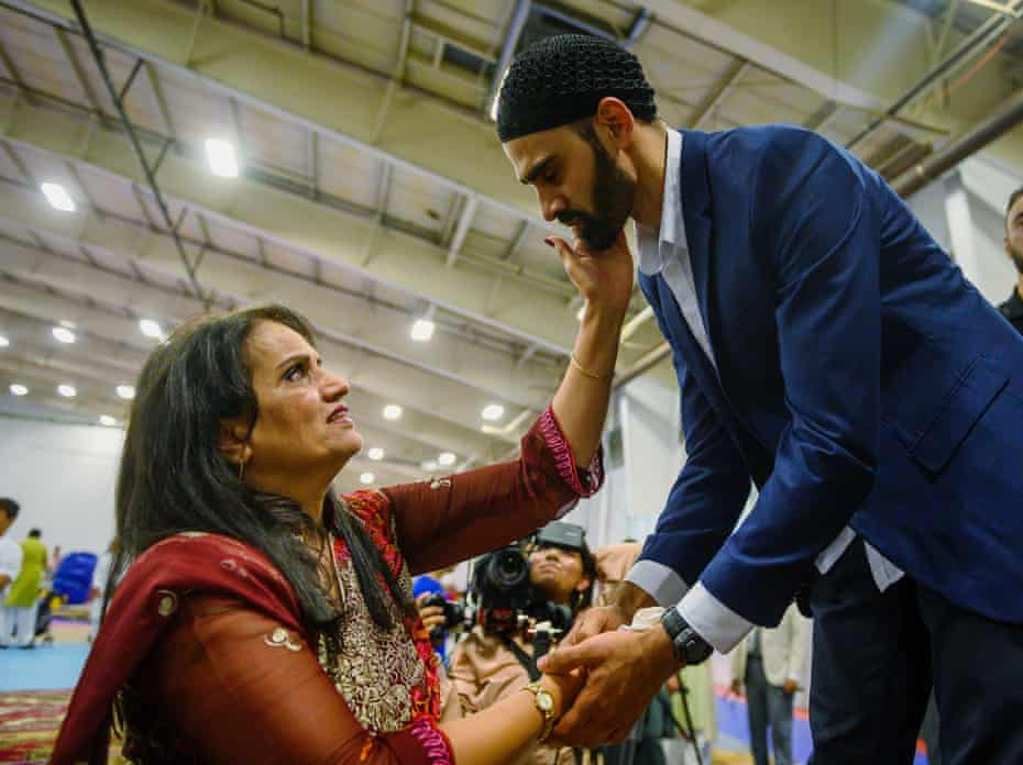 Hamid Hayat, right, is welcomed by the community after making his first public appearance at a news conference that coincided with Eid al-Adha in Sacramento, California, in 2019.