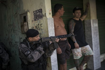 policeman with guns and residents