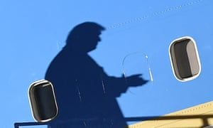 The shadow of Donald Trump falls across Air Force One as he arrived at a campaign rally yesterday.