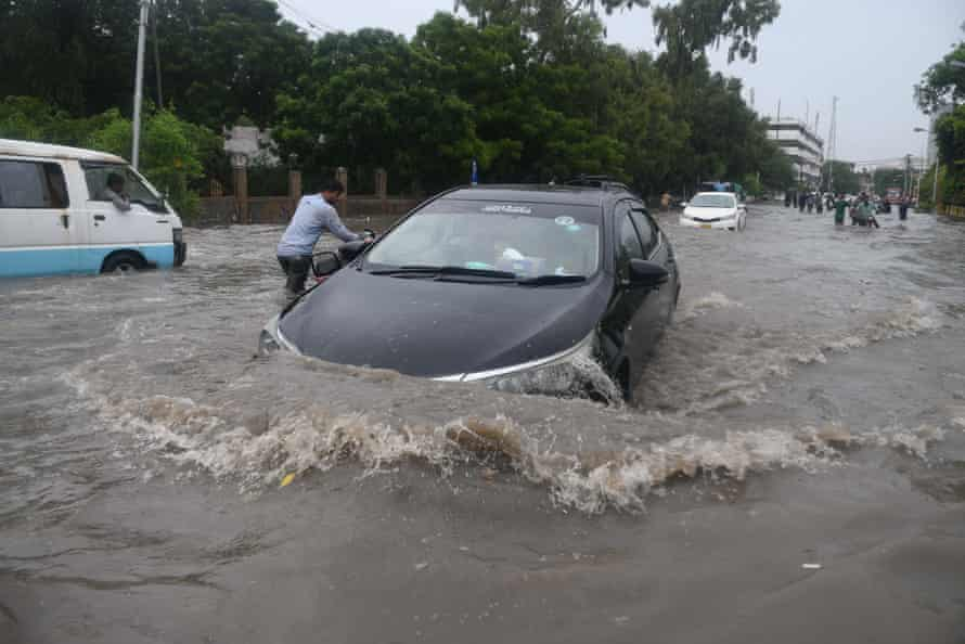 A vehicle caught in floods in Karachi.