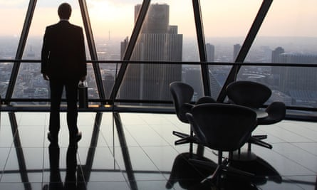 A businessman looks out of his office window