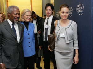 Actors Angelina Jolie and Brad Pitt leave at the end of the session opened by Annan at the the World Economic Forum in Davos in 2006
