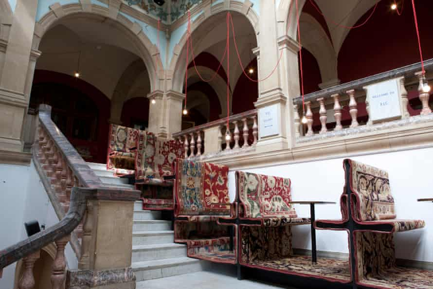 Battersea Arts Centre, staircase seats and tables, covered with carpet, press image from Haworth Tompkins, architects