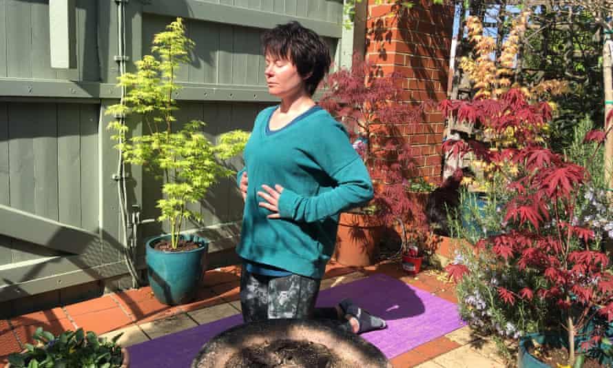 Rachel Dixon practises calm breathing in her back garden