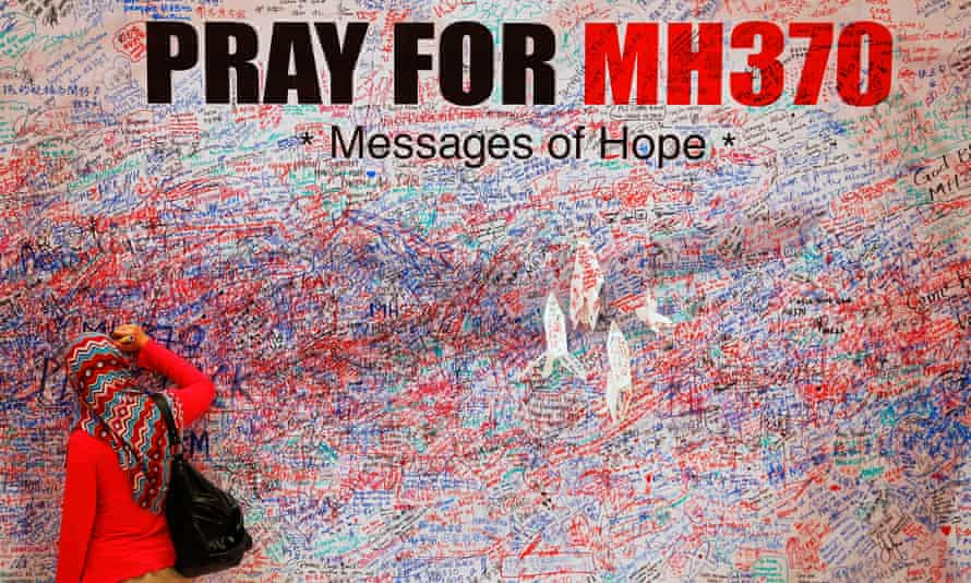 A woman leaves message of support for passengers of missing Malaysia Airlines MH370.